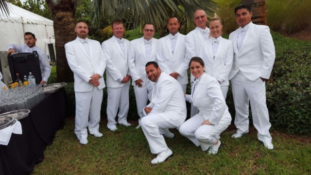 Our Staff at a Wedding in white tuxedo suits